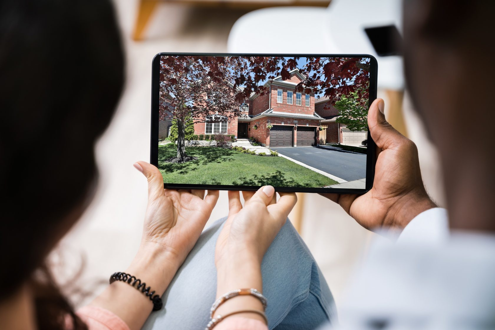 Couple looking at virtual open house on an iPad